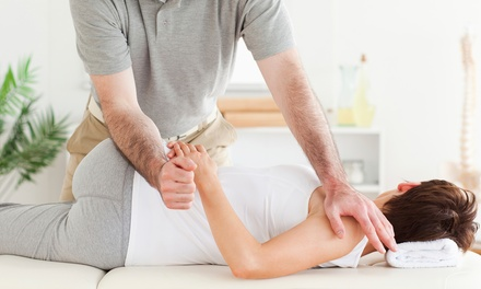 Chiropractic Package with 1 or 4 Adjustments at 100 Percent Chiropractic-Colorado Springs East (Up to 70% Off)