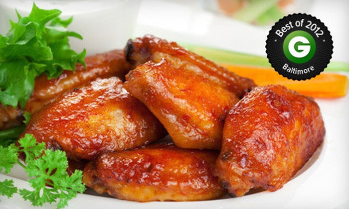 Loafers Sports Bar and Grill - Multiple Locations: Pub Food and Drinks at Loafers Sports Bar and Grill (Up to 58% Off). Two Options Available.