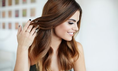 image for Wash, Cut and Blow-Dry with Optional Root Regrowth or Highlights at Platinum Hair and Tanning (Up to 52% Off)