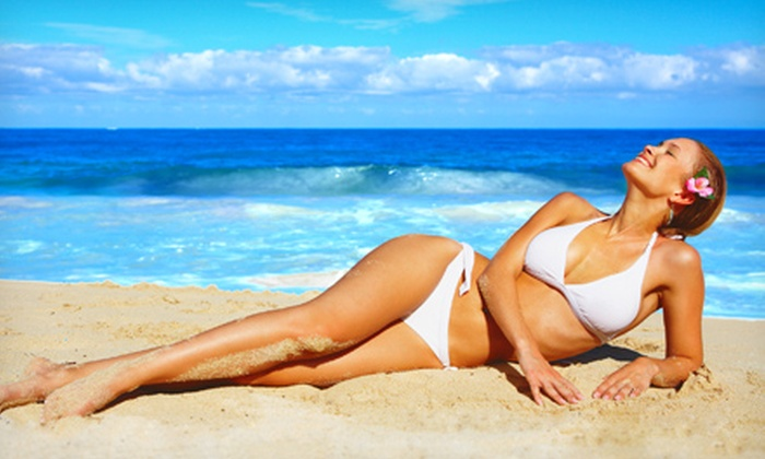 Aloha Tans - St. John's: 75 Minutes of Bed Tanning with Optional Stand-Up Tanning, or One Month of Bed Tanning at Aloha Tans (Up to 51% Off)
