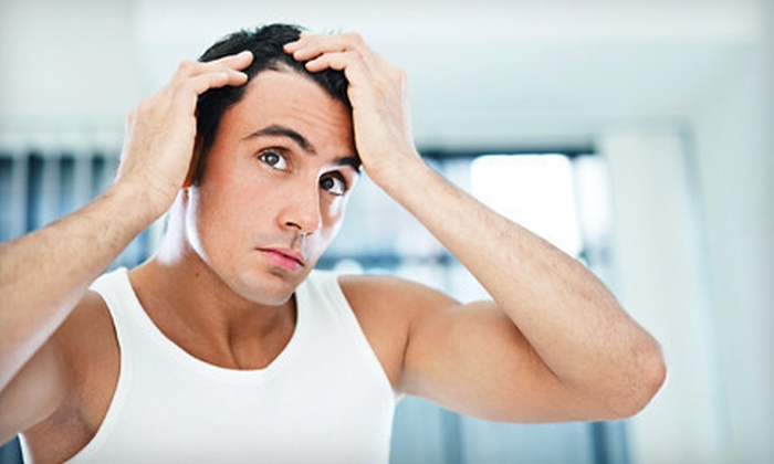 Kennedy's All American Barber Club - Colonial Townpark: $199 for Laser Hair Restoration at Kennedy's All American Barber Club in Lake Mary ($1,926 Value)