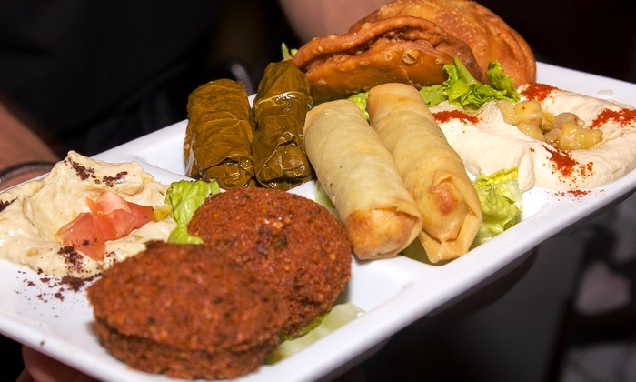 Zikrayet Lebanese Restaurant & Lounge - Eisenhower East - Carlyle District: Middle Eastern Food for Two or Four at Zikrayet Lebanese Restaurant & Lounge (Up to 50% Off)