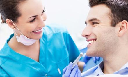 Visita odontoiatrica con pulizia denti, sbiancamento LED e otturazione