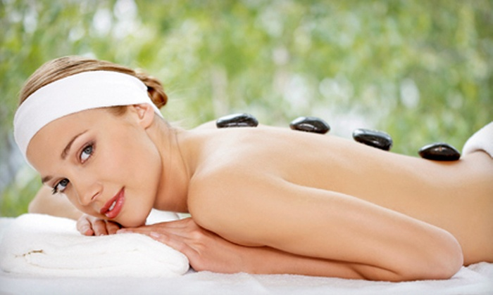 Sunset Skin Care - Paradise: Swedish Massage, Facial, or Both, or Hot-Stone Massage with Reflexology at Sunset Skin Care (Up to 61% Off)