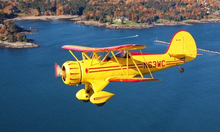Biplane Rides Over Atlanta - 57th Fighter Group Restaurant: $110 for an Open-Air Biplane Ride for One from Biplane Rides Over Atlanta ($175 Value)