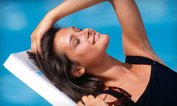 The Tan Company - Multiple Locations: Two Mystic Tan Spray Tans or One Week of Unlimited UV Tanning in Any Level Bed at The Tan Company (Up to 58% Off)