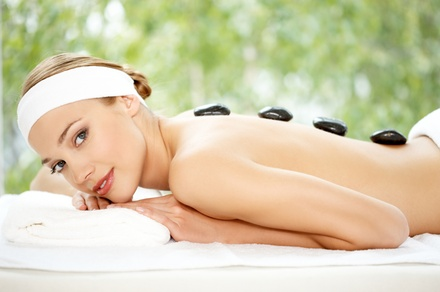 One or Three Deep-Tissue and Hot Stones Massages at Healing Through Touch (Up to 60% Off)