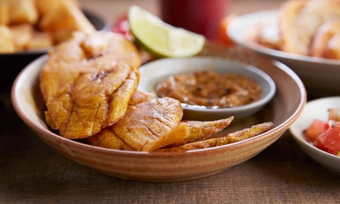 Tap Tap Haitian Restaurant - South Beach: Haitian Food for Two or Four at Tap Tap Haitian Restaurant (Up to 56% Off)