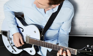 Music Centre Canada: Four or Eight 30-Minute Guitar, Drum, Ukulele, or Bass Lessons at Music Centre Canada (Up to 52% Off)