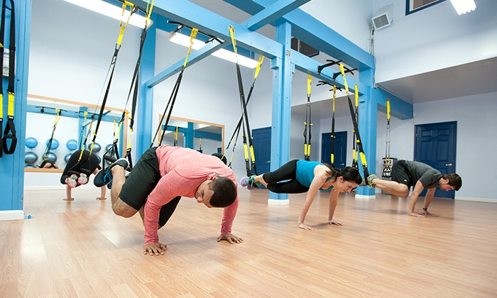 bodyFi - Multiple Locations: Four or Eight TRX Fitness Classes at bodyFi (Up to 64% Off)
