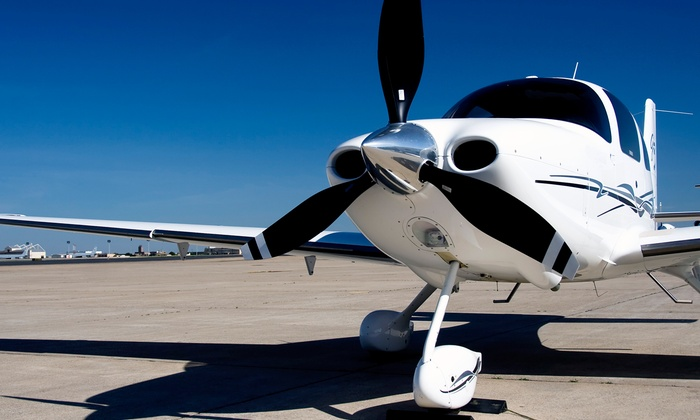 Louis Fly Academy - Farmingdale: $109 for a One-Hour Private Flight Lesson with Logbook and Photo from Louis Fly Academy ($198 Value)