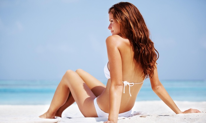 Tarzy Salon - West Newport Beach: Four Airbrush Tanning Sessions at Tarzysalon (72% Off)