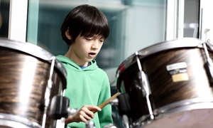 Rock This Way! School of Rock: Two or Four 30-Minute Private Guitar, Drum, Vocal, Piano, or Bass Lessons at Rock This Way! School of Rock (Up to 58% Off)