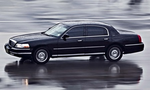 Border Limousine Service: Roundtrip Airport Transportation in a Sedan or a Van or SUV from Border Limousine Service (Up to 47% Off)
