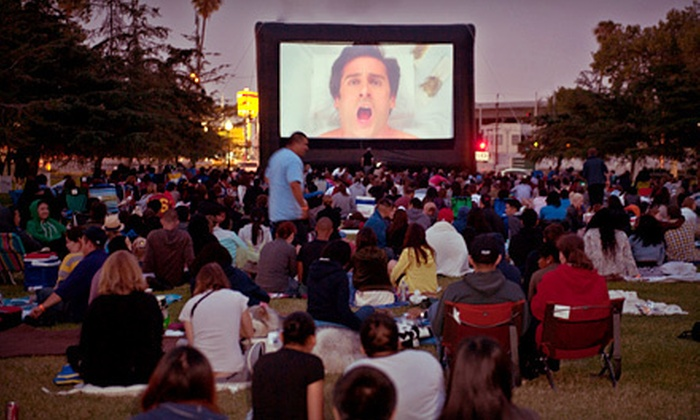 "Street Food Cinema - Exposition Park (Pulp Fiction Showing): Outdoor ""Transformers"" or ""Twilight"" Screening with Shave Ice for Two or Four at Street Food Cinema (Up to 52% Off)"