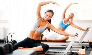 Pilates For Life: 4, 8, or 12 Group Pilates Classes, or Pole Pilates Class at Pilates For Life (Up to 76% Off)