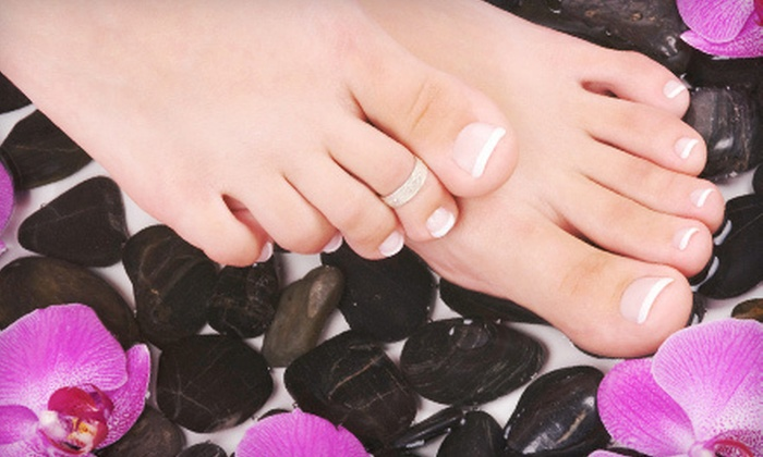 Revo Nails & Spa - Long Reach: One or Two Hot-Stone Pedicures at Revo Nails & Spa (Half Off)