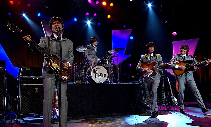 The Fab Four - Paramount Theatre: The Fab Four Beatles Tribute Band at Paramount Theatre on Saturday, February 28, at 7:30 p.m. (Up to 39% Off)