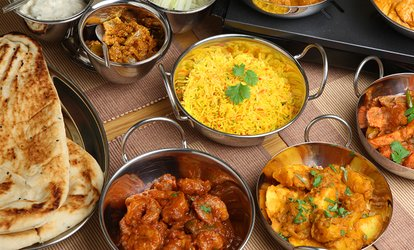 image for Two Course Indian Meal with Papadums and Pickles or Bottle of Wine for Two or Four at Miah's Kitchen (Up to 60% Off)