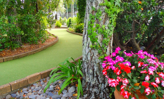 18-Hole Mini Golf with Drink for 1 ($8), 2 ($16) or 4 People ($30) at Enchanted Forest Mini Golf (Up to $56 Value)