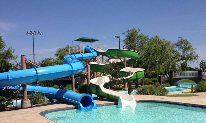 River Country Family Water Park - Muskogee: Admission for Two or Four to River Country Family Water Park (Up to 46% Off). Four Options Available.