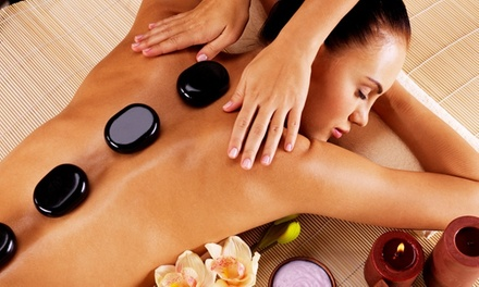 Deep-Tissue Massage with Hot Stones and Hot Oil or 60-Minute Facial at Ample Massage Spa (Up to 37% Off)
