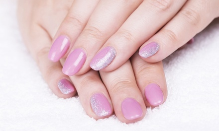Spa Manicure or Gel Spa Manicure with Paraffin Dip and Sugar Scrub at SuperNatural Hair (Up to 54% Off)