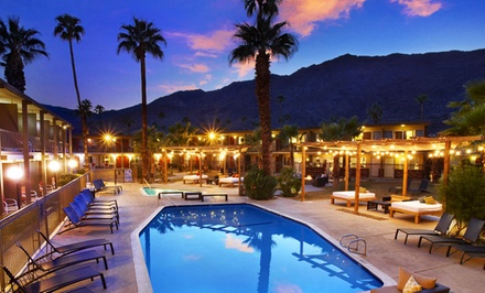 groupon daily deal - Stay with Optional Bottle of Wine at The Curve Palm Springs Hotel in Palm Springs, CA. Dates Available into May.