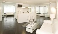 Kosmetisches Premium-Power-Bleaching für die Zähne in der White Lounge München (72% sparen*)