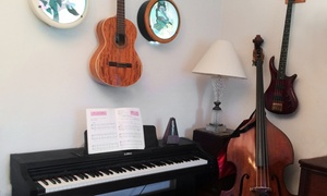 Patient Guitar, Bass and Piano Lessons: Two or Four Music Lessons at Patient Guitar, Bass and Piano Lessons (Up to 49% Off)