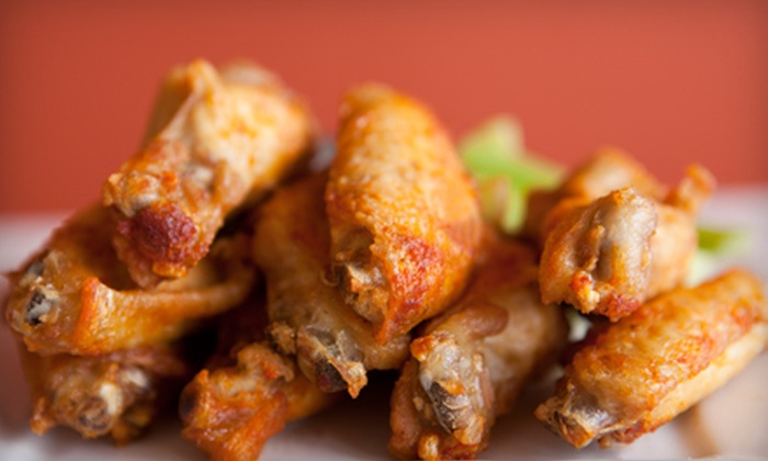 Champion Sports Bar & Grill - Holt: Pub Food and Drinks at Champion's Sports Bar & Grill (Half Off). Two Options Available.