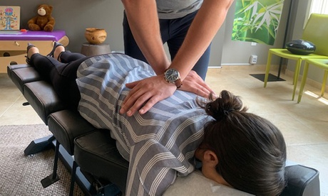Chiropractic Package with Massage, One or Three Adjustments, and X-Rays at 100% Chiropractic (Up to 85% Off)