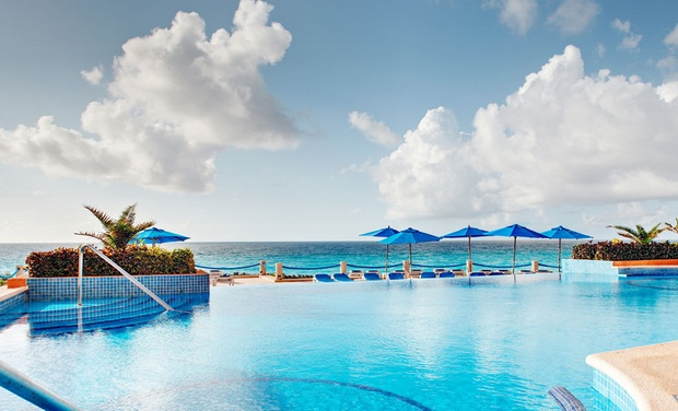 TripAlertz wants you to check out ✈ All-Inclusive Occidental Tucancún Stay w/ Air. Price per Person Based on Dbl Occupancy (Buy 1 Groupon/Person) ✈ All-Inclusive Occidental Tucancún Stay with Air From Apple Vacations - All-Inclusive Mexico Vacation