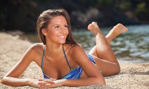 Touch of Sun Tanning Salon: Three or Five Spray Tans at Touch of Sun Tanning Salon (Up to 69% Off)