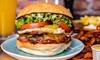 Burger mit Pommes und Getränk