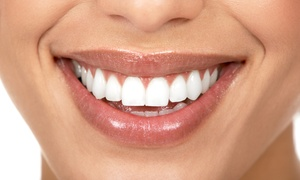 Village Family Dental: Zoom Teeth-Whitening Treatment or Teeth Cleaning at Village Family Dental (Up to 86% Off)
