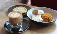 Main, Hot Drink and a Cookie for One or Two at Navaho Coffee (Up to 46% Off)