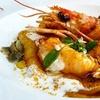 Menu di pesce con sorbetto e calice di vino