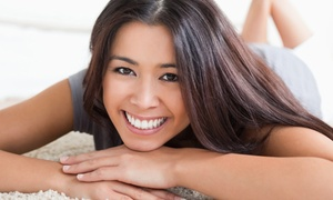 Noll Family Dentistry: Dental-Exam or Tooth-Repair Package with In-Office Teeth Whitening at Noll Family Dentistry (Up to 86% Off)