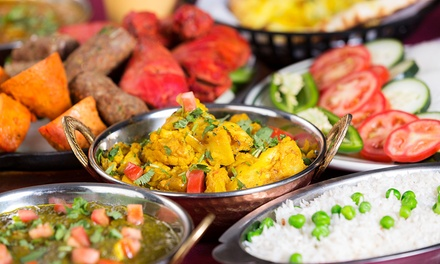 ThreeCourse Indian Meal + Glass of Wine for Two $35 or Four People $69 at Joy of India Up to $226.40 Value
