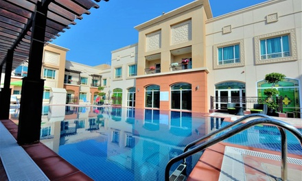 RAK: 1 Night for Up to 4 Adults and 2 Children with Option for Breakfast and Beach Access at Mughal Suites