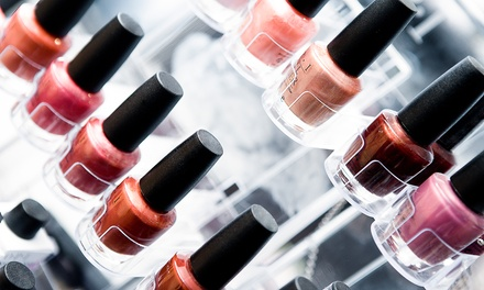 One or Two Traditional or Gel Mani-Pedi Packages at First Glance Hair and Nail Salon (Up to 54% Off)