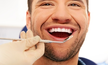 Dental Exam, Cleaning, and X-Rays with Optional Whitening Kit or Color Filling at Beyond Dental (Up to 88% Off)