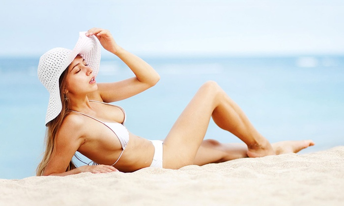 Spray Tanning or Bed Tanning at Desert Escape Tanning Center (Up to 67% Off)