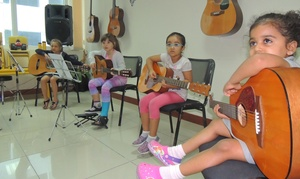 Solid Rock Music and Dance Zone: Four or Eight Guitar, Piano or Drums Lessons at Solid Rock Music and Dance Zone