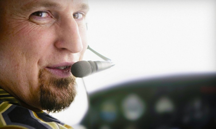 Wallis Aviation - Wallis Aviation: Introductory Flight Lesson or a One-Hour Scenic Tour for Two from Wallis Aviation (Up to 55% Off)
