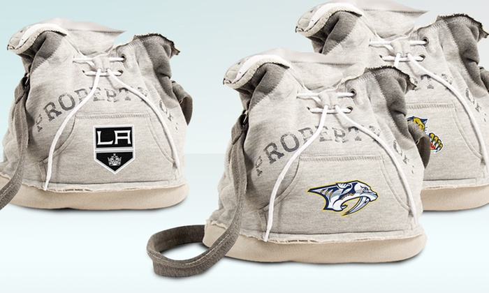 NHL Hoodie Duffel Bag: NHL Hoodie Duffel Bag. Multiple Teams Available. Free Returns.