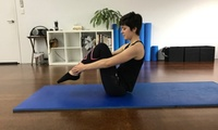 Seven Days of Unlimited Pilates Mat Classes for 1 ($15) or 2 People ($29) at Stomping Ground Studios (Up to $260 Value)