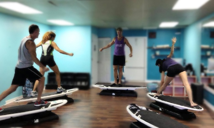 Surf Fit of Tampa, LLC - Ballast Point: 6 or 12 Indoor Surfboard Fitness Classes, or One Month of Classes at Surf Fit of Tampa, LLC (Up to 66% Off)