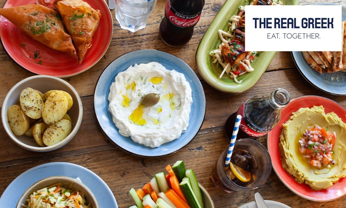 Eight Greek Meze and Sides to Share Plus Drink Each for Two at The Real Greek, Multiple Locations (Up to 55% Off)